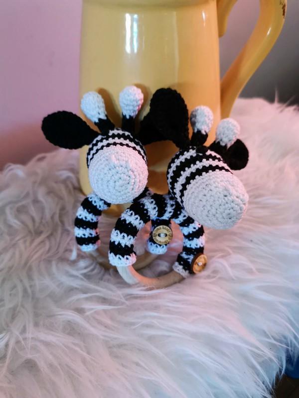 Rammelaar/bijtring giraf zwart/wit
